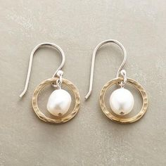 """PEARLS IN HOOPS EARRINGS - Sterling silver rings coated with 14kt gold orbit around cultured pearls in this pair of pearls in hoops earrings. Sterling silver French wires. Exclusive. Handmade in USA. 1""""L."""
