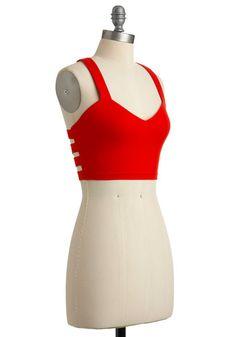little red dress, little red shirt!  http://www.modcloth.com/shop/sleeveless-tops/double-dahlia-dare-top