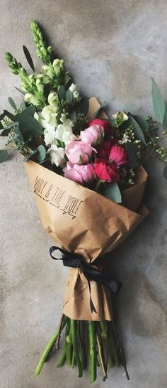 Flowers wrapped in brown paper bags.