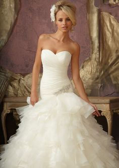 Mori Lee. Fit and flare 1856. I like the top