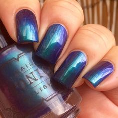 Tonic Polish - Dragons at Dusk | Debut Collection | June 26, 2016 | Dragons at Dusk is a dark peacock-blue jelly base with a strong emerald/blue/violet shifting multi chrome summer.