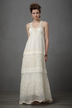 Nicosia Gardens Gown - $3,000  Is this a wedding gown, or a beachy cocktail dress? The decision is yours to make. http://www.hellobrit.com/weddings/16-non-traditional-wedding-dresses-for-the-modern-bride/