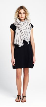 i love the chunky scarf paired with a simple dress and flats. I want to be able to pull this off!