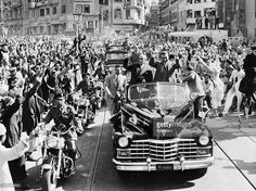 Cairo, Egypt- Cheering crowds surround the car in which Egyptian President Gamel Abdel Nasser (R) and Syrian President Shukri al-Kuwatly ride to the presidency to sign the papers making final the merger of Egypt and Syria into a United Arab State. Yemen is also reportedly going to join the union, but by federation, not integration.