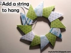 Origami Wreath Tutorial.  I used origami paper, I did not have luck with scrapbook paper.