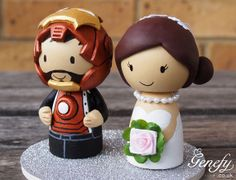 Cute IRONMAN and bride wedding cake topper