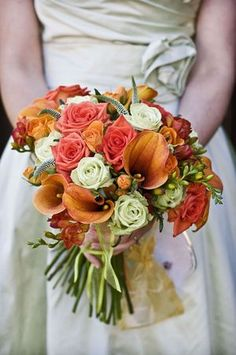 Orange wedding bouquet. View more tips & ideas on our Facebook Page : https://www.facebook.com/BoutiqueBridalParty