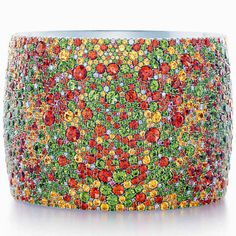 TIFFANY & CO. The Seurat Bangle composed in 18k white gold with spessartites, tsavorites, yellow sapphires, diamonds and fancy sapphires ava...