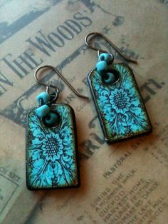 From GlassHouseDesigns...Aqua Teal Victorian Scroll Dog Tag Wood Tile decoupaged by Artisan, earrings. $17.50, via Etsy.