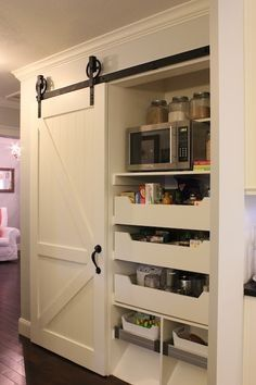 For where fridge is now.microwave, pullouts, and a barn door.A Tree Lined Street: The {Barn Door} Pantry. Great DIY barn door and Ikea pull-outs Kitchen Pantry, Doors, Custom Kitchens, Home, Home Kitchens, Diy Kitchen Storage, Remodel, Barn Door Pantry, Home Projects
