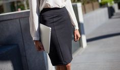 Betabrand Work-It Skirt 2.0 front fit shot with laptop in hand