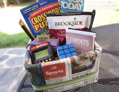 A Newsworthy Gift - Because all dads are different this basket can really be filled with just about anything.  But for some ideas here is what I included in this one:  - Crossword puzzles - Book -Yahtzee game - Rubik's cube - Tie - Tie pin - Candy - Shoe horn - Pens & Pencils - And the rest of the newspaper