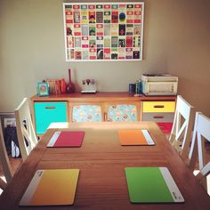 Dining room with a pop of colour - Pantone placemats, up cycled sideboard and Penguin postcards