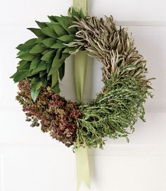 For food fans: Combine sage, oregano, rosemary, and bay leaves to create a wreath Made of Edible Herbs inspired by savory holiday dishes.