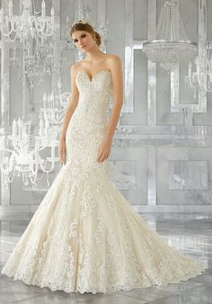 "Breathtaking and Timeless, This Stunning Fit and Flare Wedding Gown Features Frosted, Embroidered Appliqués on Tulle Over Sparkle Net. A Wide Scalloped Hemline and Sheer Back with Exposed Boning Complete the Look. Shown with Detachable Tulle Over Sparkle Net Train (not included), Sold Separately as Style# 11271. Available in Three Lengths: 55"", 58"", 61"". Colors Available: White, Ivory, Ivory/Light Gold."