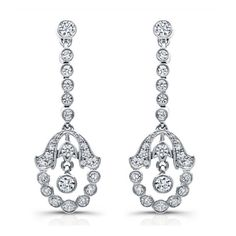 With luxurious splendor, these sensational drop chandelier style 18k white gold earrings feature milgrain framed diamonds. They are available in 14k or 18k white, rose and yellow gold, as well as platinum.