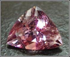 Poudretteite :: A very rare gem, first found in Mont St. Hilaire, Quebec, Canada. Named after the Poudrette family who were the operators of the quarry where it was first discovered. Photo courtesy of Scott Davies, americanthai.com