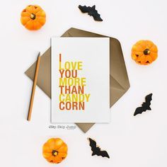 Halloween Card, I Love You More Than Candy Corn, A2 size, shown in lemon and orange  This 4.25 x 5.5 greeting card is printed on cardstock. An A2 size white envelope is included. The shop logo is discreetlyplaced on the back of each card. The inside of the card is blank.  PLEASE