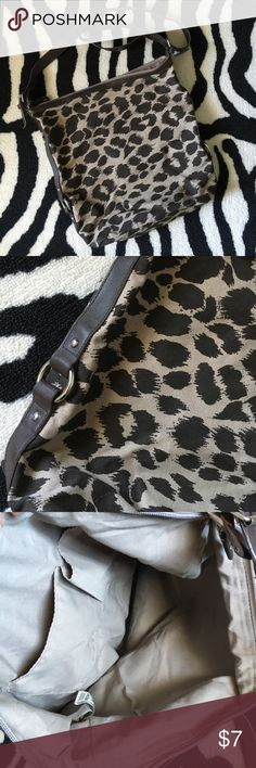 "Old Navy leopard crossbody tote Old Navy leopard crossbody tote. Measures approx 14"" x 14"" with a long adjustable crossbody strap. In great preloved condition. No stains. Minor wear to strap (pictured). Great for a casual day or for the pool/beach! Old Navy Bags Crossbody Bags"