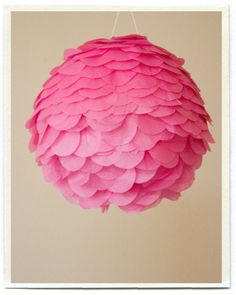 This is acually a pink petal pinata, but I think the look (perhaps on a styrofoam ball) would be nice with hanging paper lanterns.