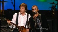 """Paul McCartney, tenor ukulele,  & Ringo Starr, vocals (and large multi-instrumental band backup) performing """"With a Little Help From My Friends"""" in concert 2009."""