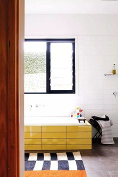 From simple scrubbing and styling to selective redecorating, even the least-loved bathroom can be made gorgeous Yellow Cabinets, Dream Bathrooms, Tile Patterns, Clawfoot Bathtub, Bathroom Inspiration, House Colors, Tiles, Make It Yourself, Simple