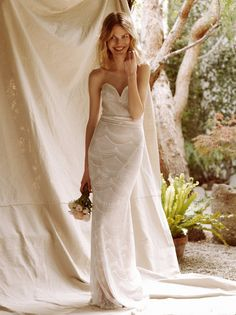 Market Gown | Made in Los Angeles, this beautiful and ethereal mermaid style gown is in a strapless style with a sweetheart neckline. Sheer mesh with allover embroidery detailing. Exposed back zip. Lined.
