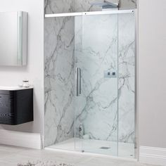 Perfect for your master bathroom, this sliding shower enclosure has an easy clean coating, because life's too short to be scrubbing glass! And the marble tiles are just wow!