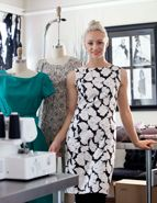 April Johnston from Project Runway in her Savannah studio modeling one of her 2012 fabric designs.