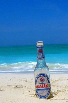 After a round of golf in the Bahamas, head to the beach and have a frosty Kalik.