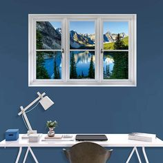 The Banff Mountains and Lake: Instant Window wall decal provides an easy decorating solution. All of Fathead's Instant Windows wall decals are reusable without damaging walls.