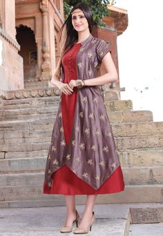 Readymade Cotton Silk Kurta in Maroon and Lilac This Impressive Drape is Regally Enhanced with Zari and Moulded Button Work. Gracefully Crafted in Round Neck and Short Sleeves Available with an Art Chanderi Silk Jacket in Lilac. The Length of the Attire is 50 inches Do Note: All accessories shown in image is for presentation purpose only. (Slight variation in actual color vs. image is possible. )