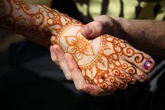 Jimi helps scrape the stubborn paste off of his bride-to-be's legs.  Rrraawwrrr.  Crimson Art Henna