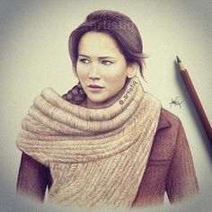 Katniss by @_artistiq on Twitter. These drawings are so realistic! It's crazy!