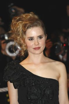 Alison Lohmans side updo hairstyle