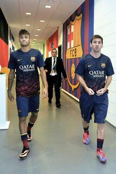 Lionel Messi Photos - Lionel Messi and Neymar walk down the players tunnel during a Pre Season Friendly match between Lechia Gdansk and FC Barcelona on July 2013 in Gdansk, Poland.