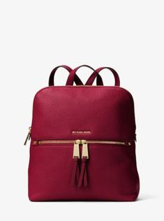 Refreshed in a sleek, slimmer silhouette, our Rhea backpack redefines big-city accessorizing. We love the juxtaposition of pebbled leather against the high-shine hardware. With its multiple zipper pockets, designed to stow a laptop, wallet and more, it's a feminine take on an enduring design.