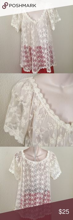 Millau Sheer Lace Bohemian Top Cream Small This is a cute Bohemian top form Millau at LF. Size small. Sheer cream Lace short sleeve. Made of 100% polyester. Mint condition. LF Tops Blouses