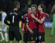 De Gea (left), Wilson (centre) and Daley Blind celebrate at the full-time whistle as Unite...