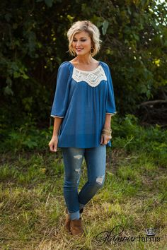 One Chic Chick Top is this season's must have! In true peasant style, this crinkle fabric top features an elastic neckline with lovely, open crocheted lace detail along the front yoke. Round neckline,