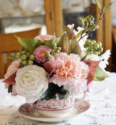 Tea cup flower centerpiece