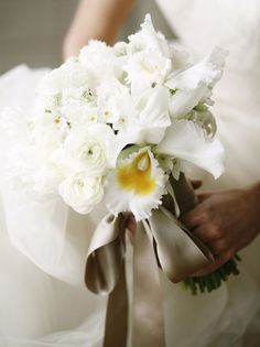 Ranuncula and orchid bouquet: #bouquet #bridal: http://belathee.com/