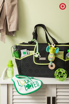 Everyone is Irish on St. Patrick's Day, and that means the wearing of the green! Before you head out with Baby to watch the St. Patty's Day parade, make sure you add a few pops of green to your look, including this tote-style diaper bag from Just One You made by Carter's. Toss in a cute bib, toys and other happy-baby essentials. Green-tinted milk is optional, but kind of awesome.