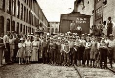 A Bad Lot: May 1911. Fries, Virginia. A part of the spinning force working in the Washington Cotton Mills. Group posed by the overseer. All work. The overseer said, These boys are a bad lot. All were alive to the need for being 14 years old when questioned. Photograph and caption by Lewis Wickes Hine.