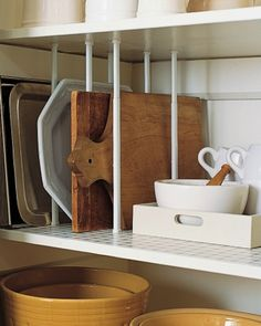 Store cutting boards and cookie sheets easily by using tension curtain rods as dividers in your cabinets.