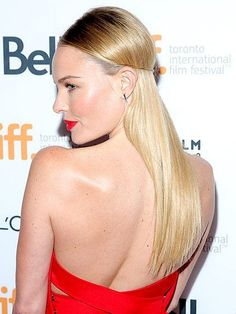 Kate Bosworth sleek half-up hairstyle with red lipstick | allure.com