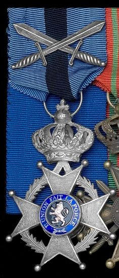 Order of Leopold II Knight's breast badge; Type 2, 1908-1951 unilingual (French); with crossed swords.