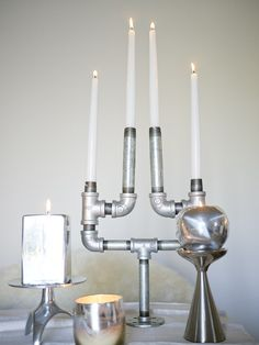 Industrial Pipe Candelabra DIY- Would be awesome and easy to make.