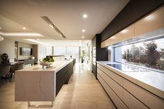 With the location being on the ocean this kitchen definitely has been designed well with a wide open window as a splashback to take advantage of the views. Sorrento Beach, New Kitchen Designs, Storey Homes, Open Window, Splashback, Open Plan Kitchen, Luxury Kitchens, Custom Homes, Luxury Homes