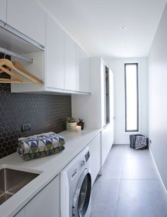 These large floor tiles are the piece-de-resistance of this stylish laundry . White Laundry Rooms, Modern Laundry Rooms, Laundry In Bathroom, Home Interior, Interior Design Living Room, Living Room Designs, Design Bedroom, Large Floor Tiles, Grey Floor Tiles